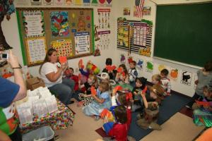 Mom reading a story to the class.