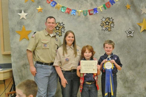 Me, my husband, my son, and a scout from our Pack we presented with the Pack of the Year Award.